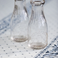 Stanley Zajk Delivery Co. Milk Bottles, mid-century